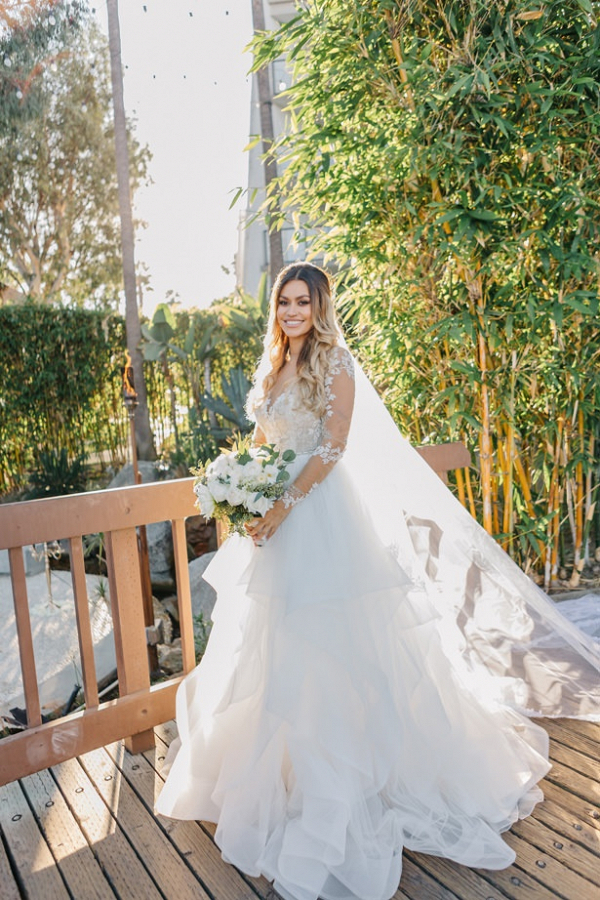 Bride in long sleeve Hayley Paige wedding dress