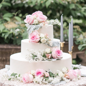 Buttercream wedding cake with pink roses