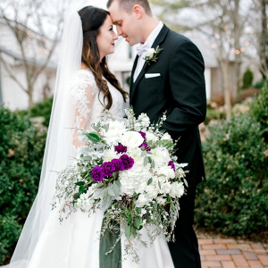 Lush white, purple, and green bridal bouquet