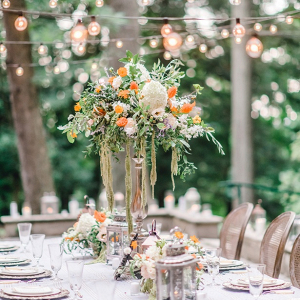 Tall white and orange wedding centerpiece