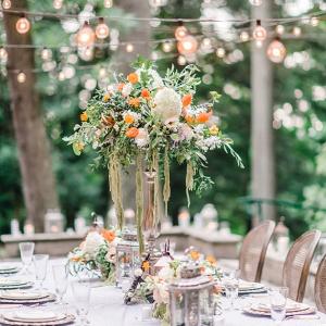 Tall white and orange wedding centerpiece