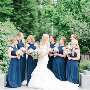 Bridesmaids in long navy dresses
