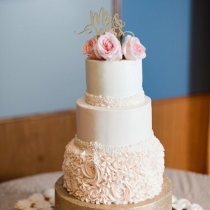 Classic pink and gold wedding cake