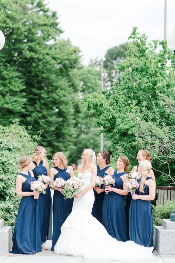 Bridesmaids in long navy dresses