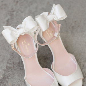 White bow heels on Belle the Magazine
