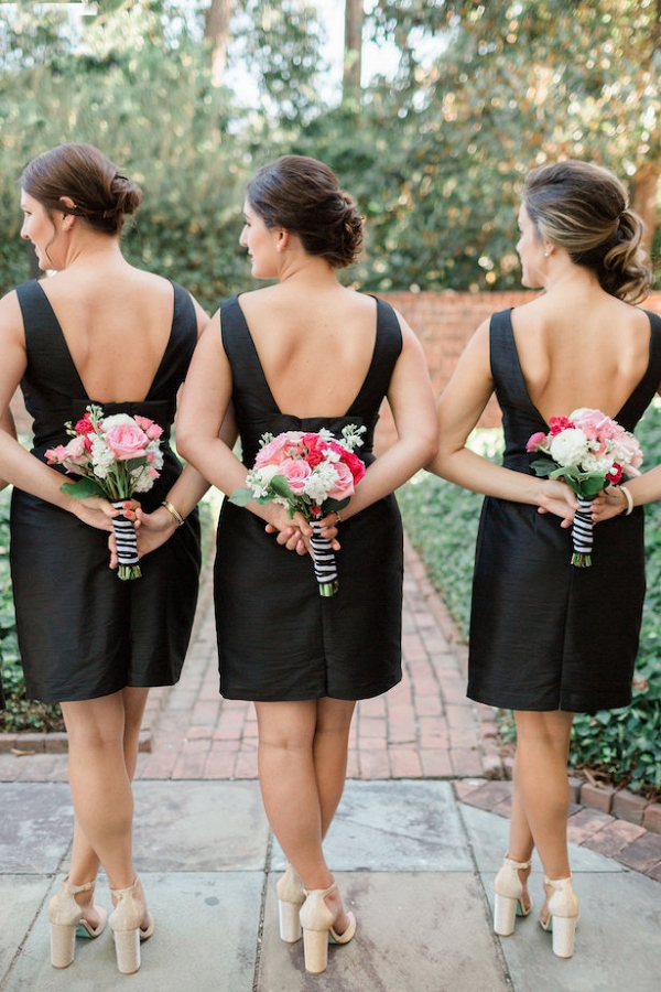 Bridesmaids in short black dresses on Belle the Magazine