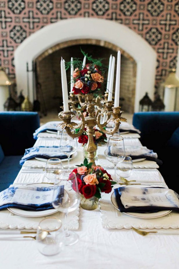 Elegant wedding table in navy and red with candelabras