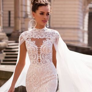 Lace wedding dress with bridal cape