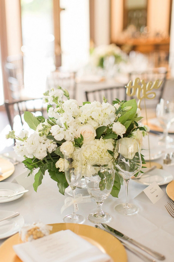 Classic white wedding centerpiece with laser cut table numbers