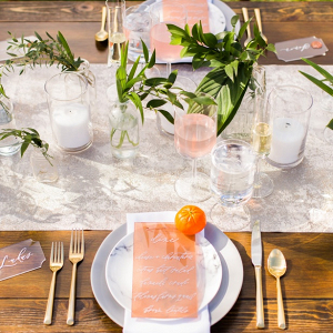 Modern orange wedding tablescape