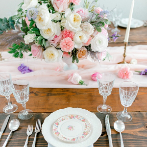 Vintage pastel wedding table with vintage floral print china