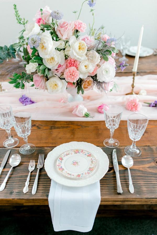Vintage pastel wedding table with vintage floral print china