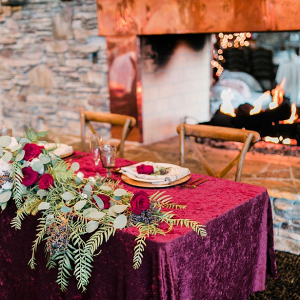 Sweetheart table by fireplace