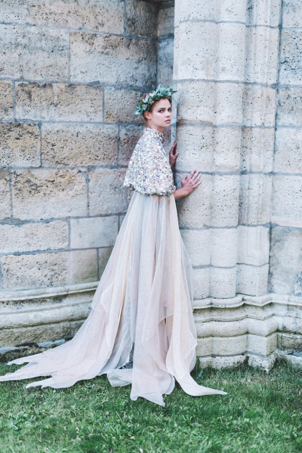 Bride in embellished cape by Eva Poleschinski Bridal Couture