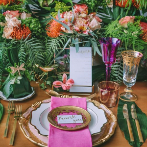 Lush tropical wedding tablescape