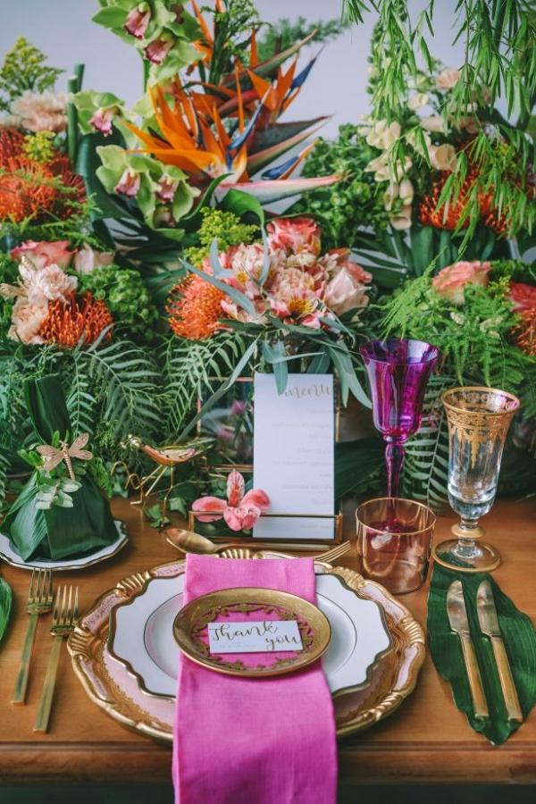Lush tropical wedding tablescape