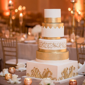 Glam gold and white wedding cake