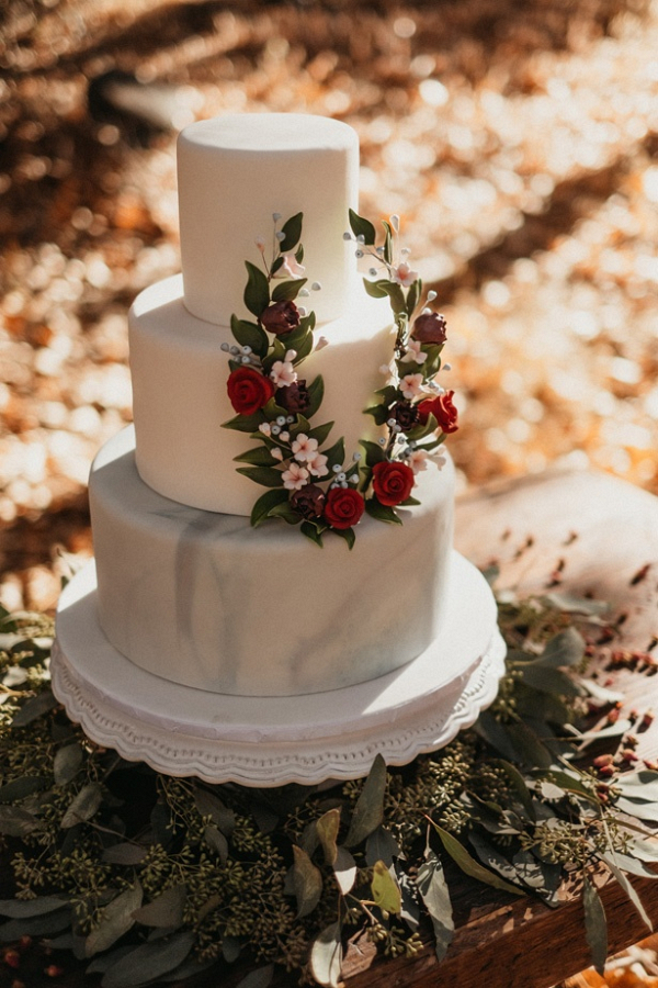 Marble wedding cake with sugar flower wreath