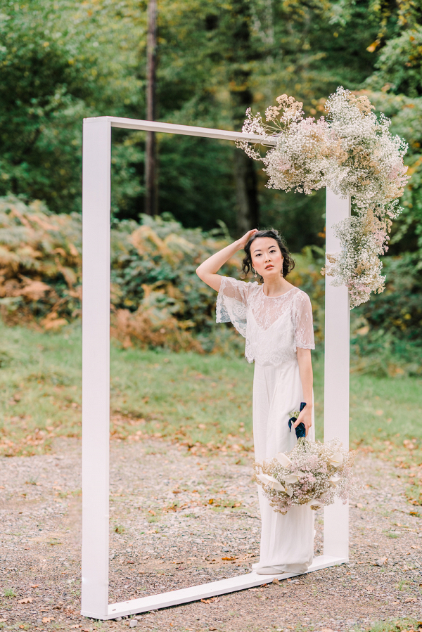 Creative square wedding ceremony arch with floating cloud of Gypsophila flowers