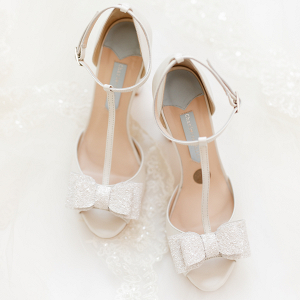 Ami's white sparkly bridal shoes with glitter bows