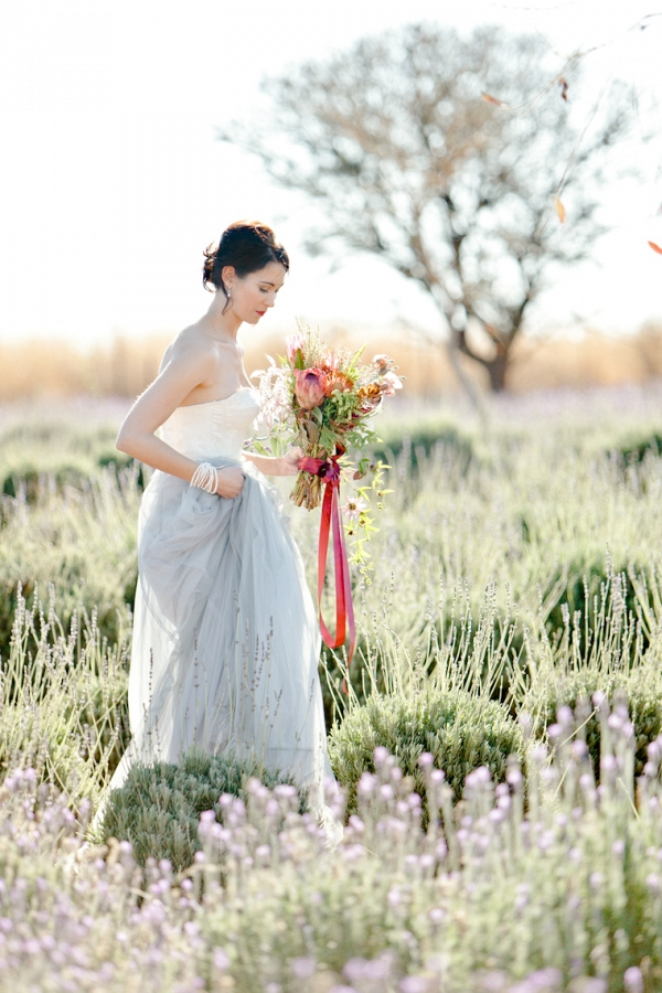 walking amongst the lavender fields with a beautiful bouquet of flowers