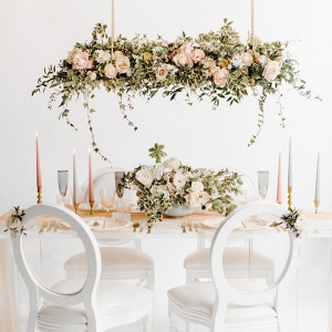 table setting concept with statement floral installation hung over the table