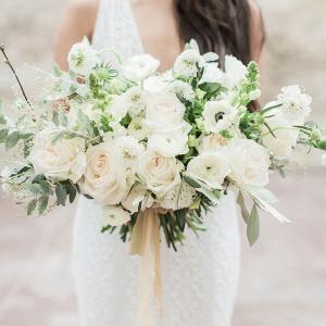 1661440d0d Elegant white bridal bouquet with soft golden silk ribbon ...