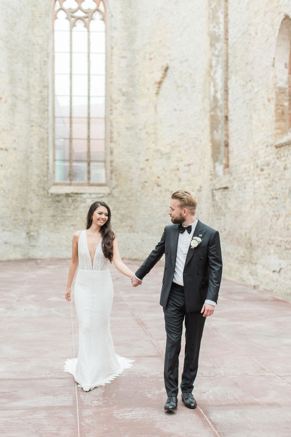 Modern elegant Bride and Groom attire and portrait in a beautiful Church