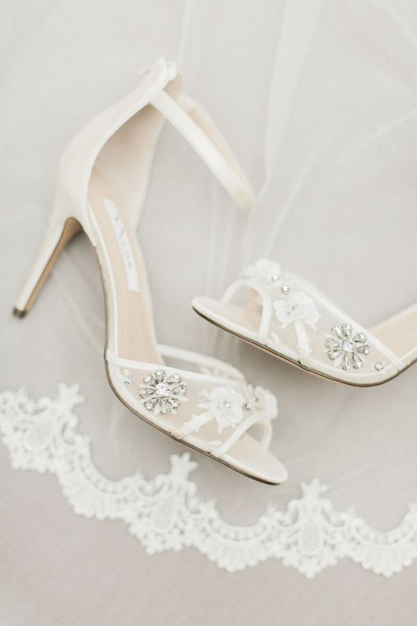 Beautiful white strappy bridal shoes with embellished details