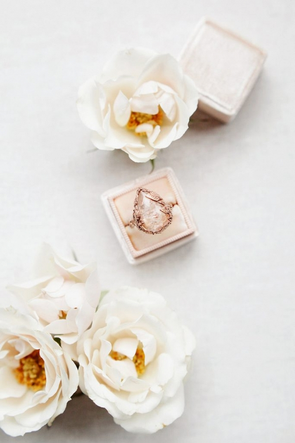 Contemporary engagement ring by Sarah Brown Jewellery framed by roses