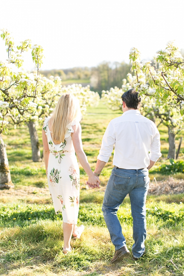 Viv and Jamie's engagement session in an orchard of blossoms