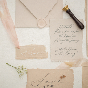 peach and white calligraphy stationery set with wax seals