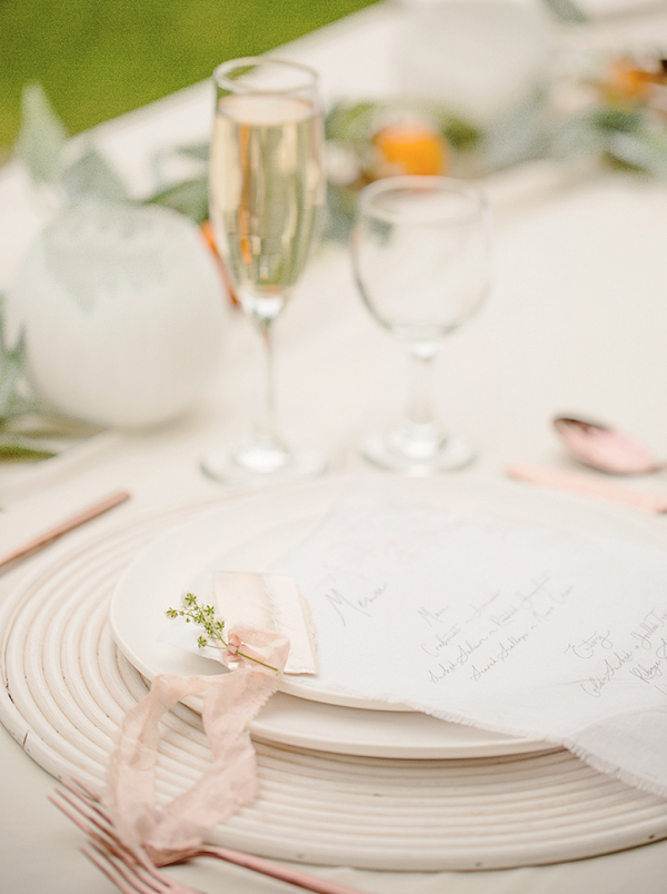 tablescape and place setting in peach and white