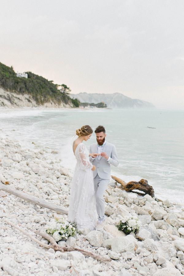bride and groom portrait wearing a pale blue linen suit