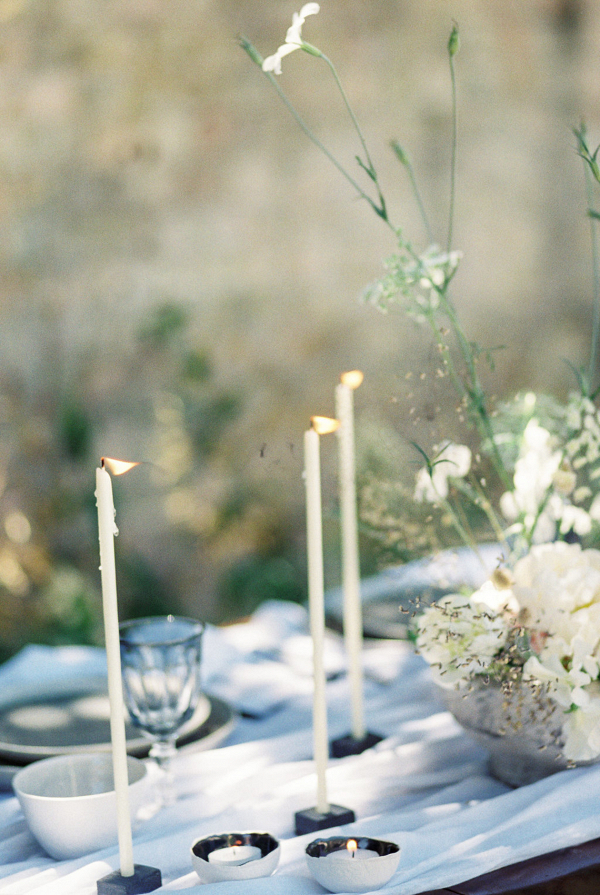 Modern Fine Art tablescape with taper candles and ceramics
