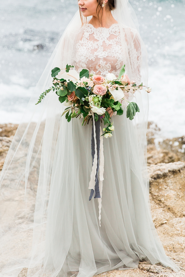 blue tulle wedding dress with lace top and beautiful bridal bouquet of flowers