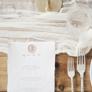 Place setting design with elegant menu and silver cutlery