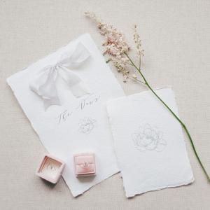 elegant white wedding stationery with pink flowers and velvet ring box