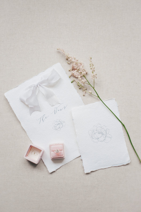elegant white wedding stationery with pink flowers and velvet ring box