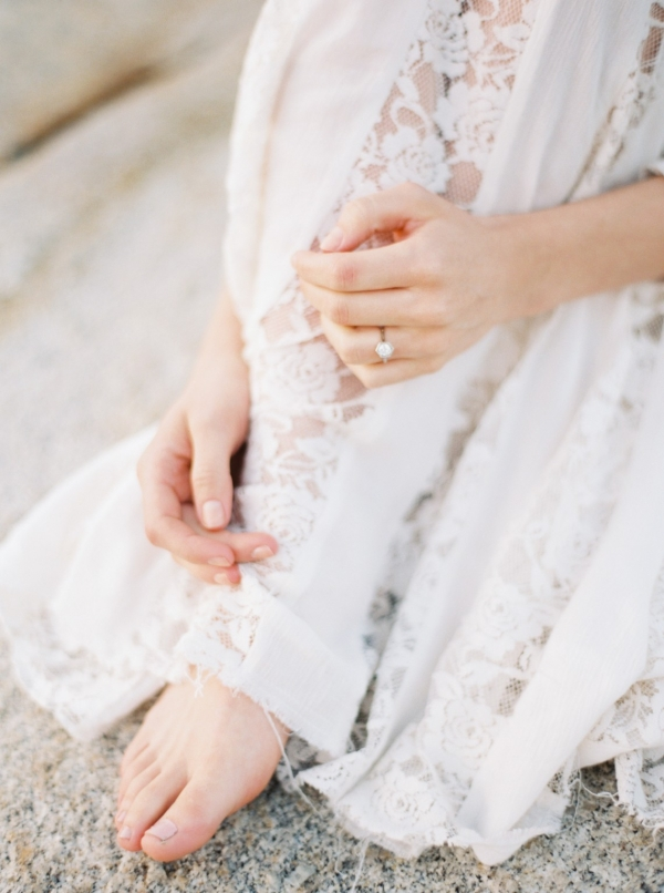 Vintage lace wedding dress on a barefoot bride