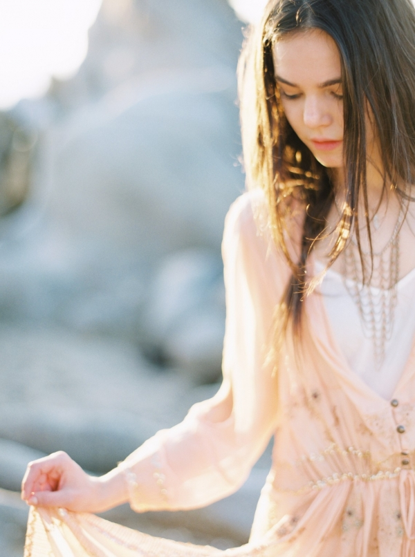 Bohemian bride to be wearing a nude boho dress with embellishment