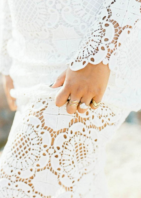 Details of the rings worn in this bohemian bridal look