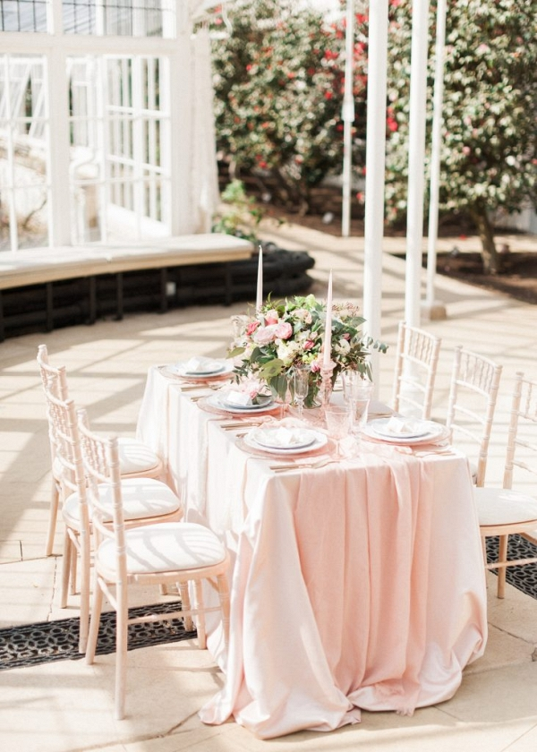 tablescape with silk runners and tall tapered candles
