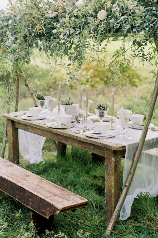 outdoor tablescape setting under floral canopy