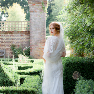 Bridal portrait and look inspired by a Mid Summer Night's Dream set in the stately gardens of bignor Park