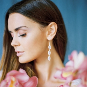 bridal portrait with blue background and pink orchid display
