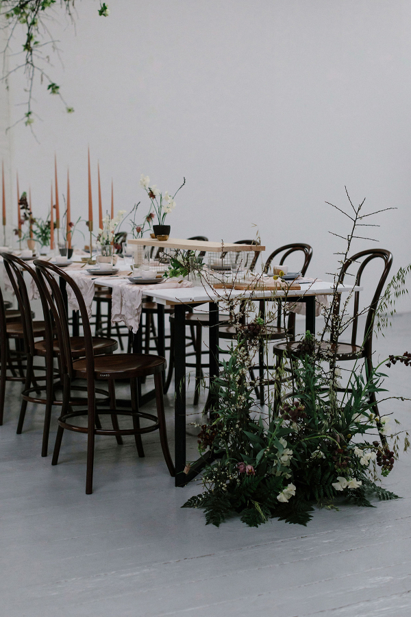 Creative table design with floor floral pieces