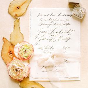 Elegant calligraphy stationery decorated with silk ribbon, and flowers