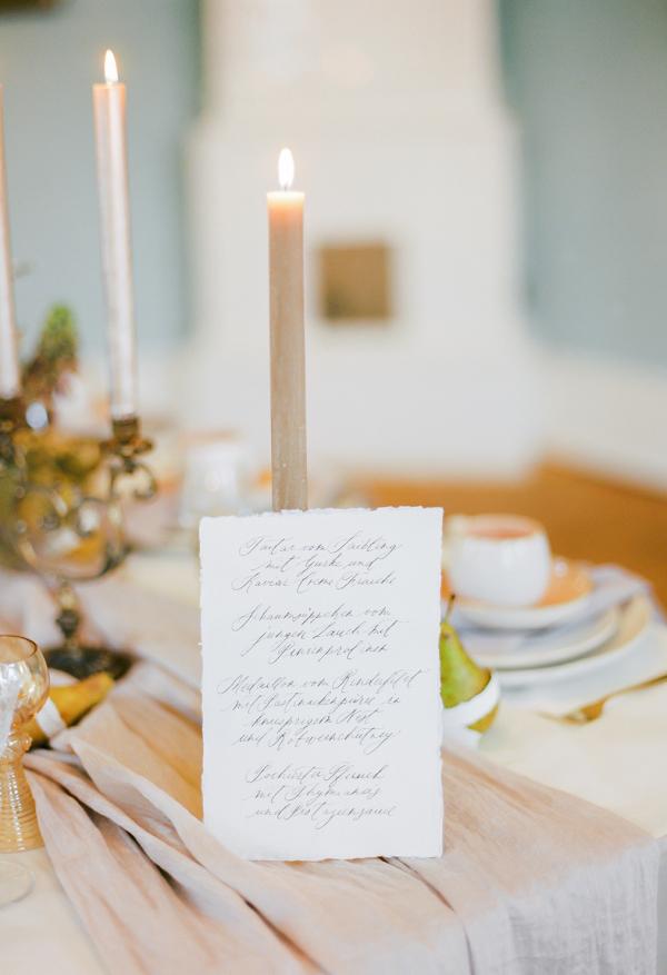 handwritten wedding menu with calligraphy writing