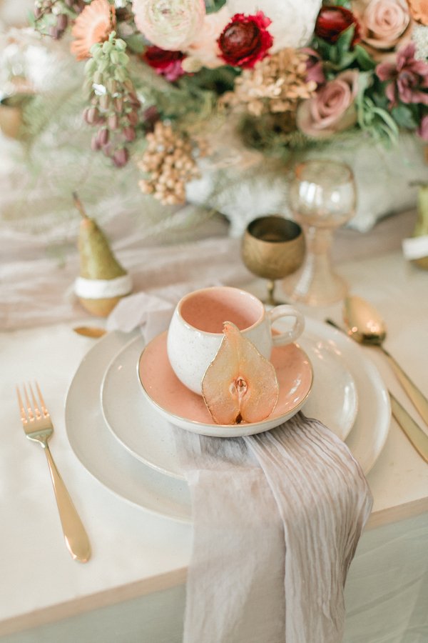 autumn wedding table decor and place setting with pear slices